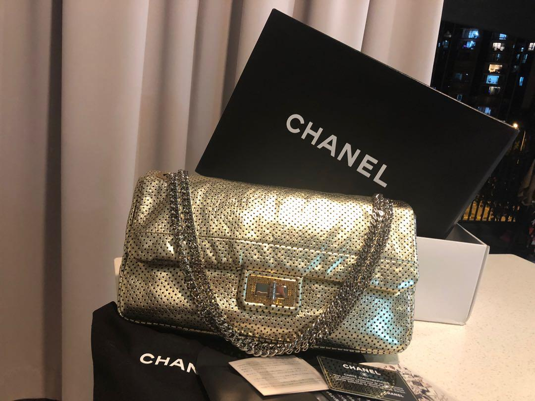 Authentic Chanel gold perforated flap bag