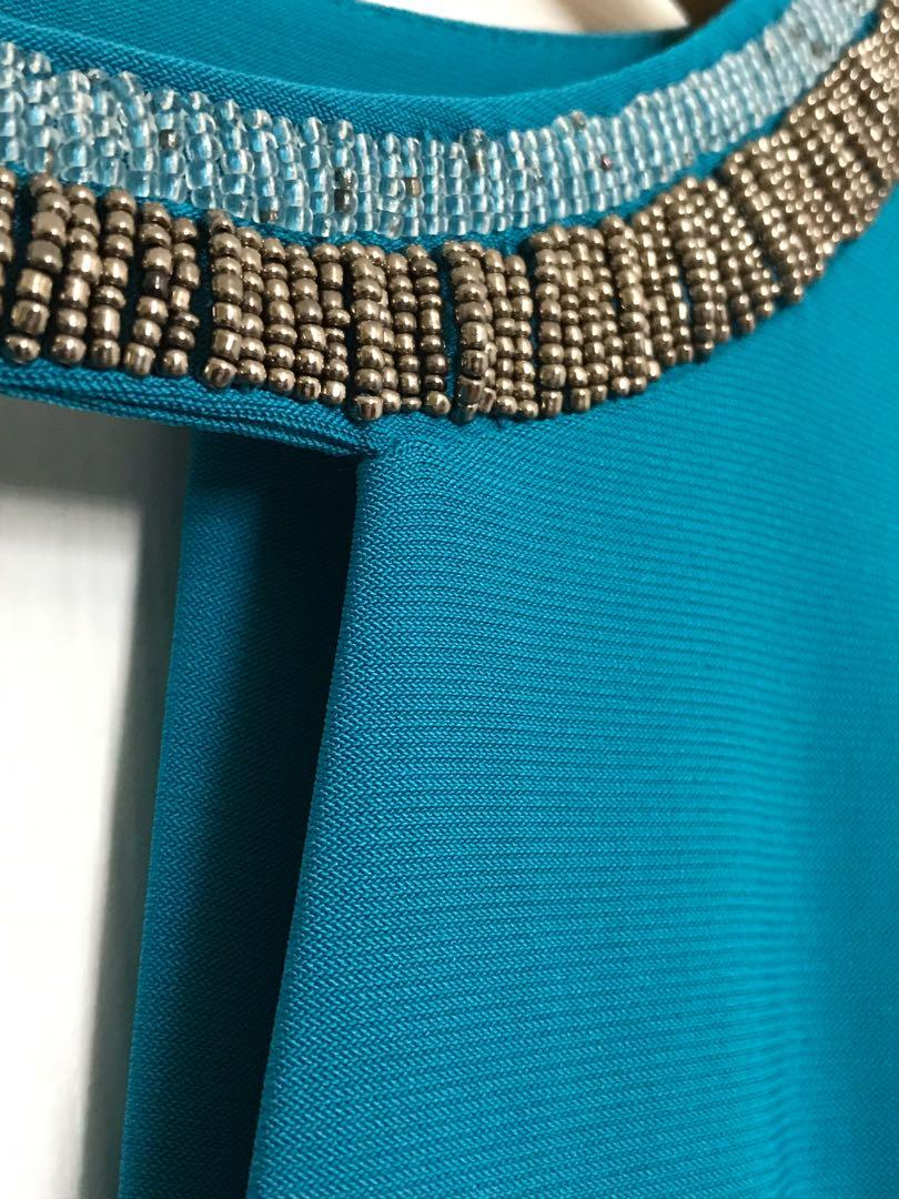 Blue No-Sleeve Dress with Beaded Neck and Chest Slit
