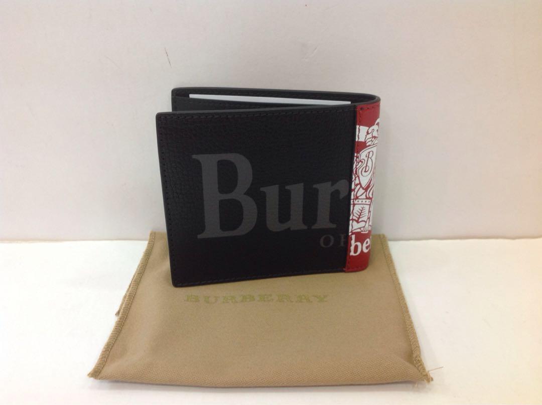 BURBERRY CREST PRINT LEATHER BI-FOLD WALLET