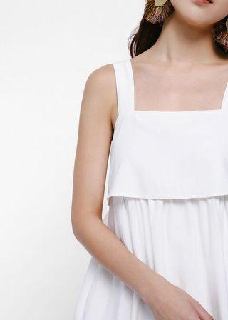 Roseni Ruffle Hem Layered Apron Dress in White