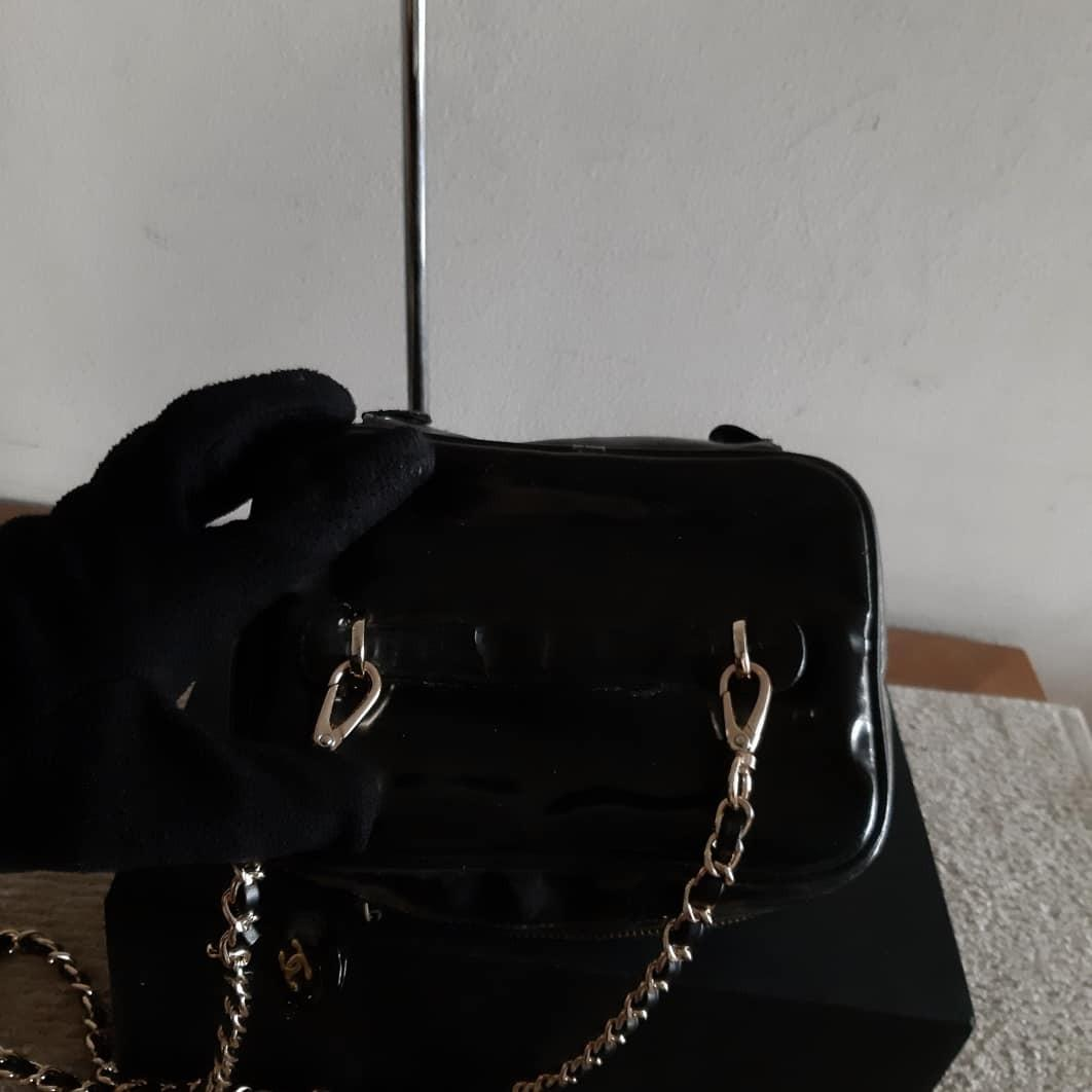 AUTHENTIC CHANEL VANITY BAG - CC LOGO DESIGN - IN SHINY BLACK PATENT LEATHER - GOLD HARDWARE - HANDLE HAS BEEN GLUED DOWN BY PREVIOUS JAPANESE OWNER - SOLID SHAPE STRUCTURE- HOLOGRAM STICKER INTACT- (COMES WITH EXTRA LONG CHAIN STRAP FOR CROSSBODY SLING