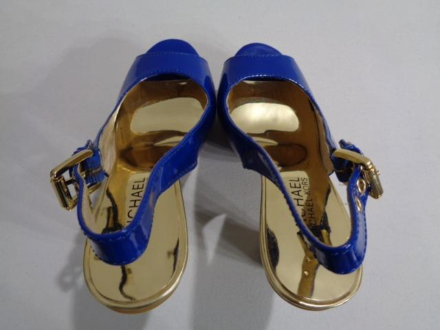 Michael Kors peeptoe's Size 5M. Cobalt and gold with rope cone heel.