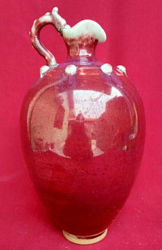 A RED TEAPOT HANDLE DRAGON