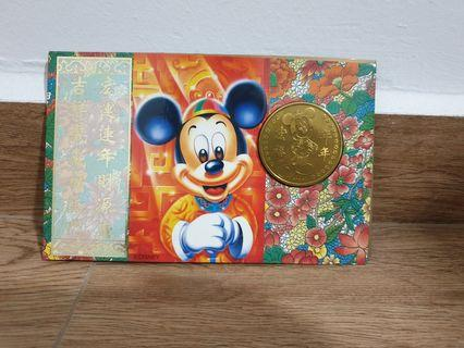 Mickey & Minnie coin with $2 note