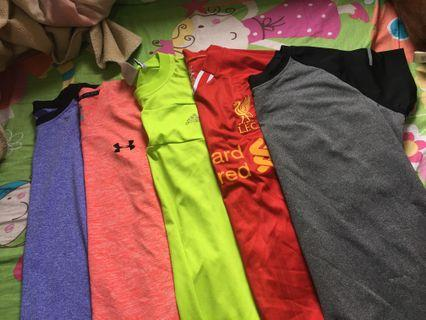 Assorted dri fit exercise tops