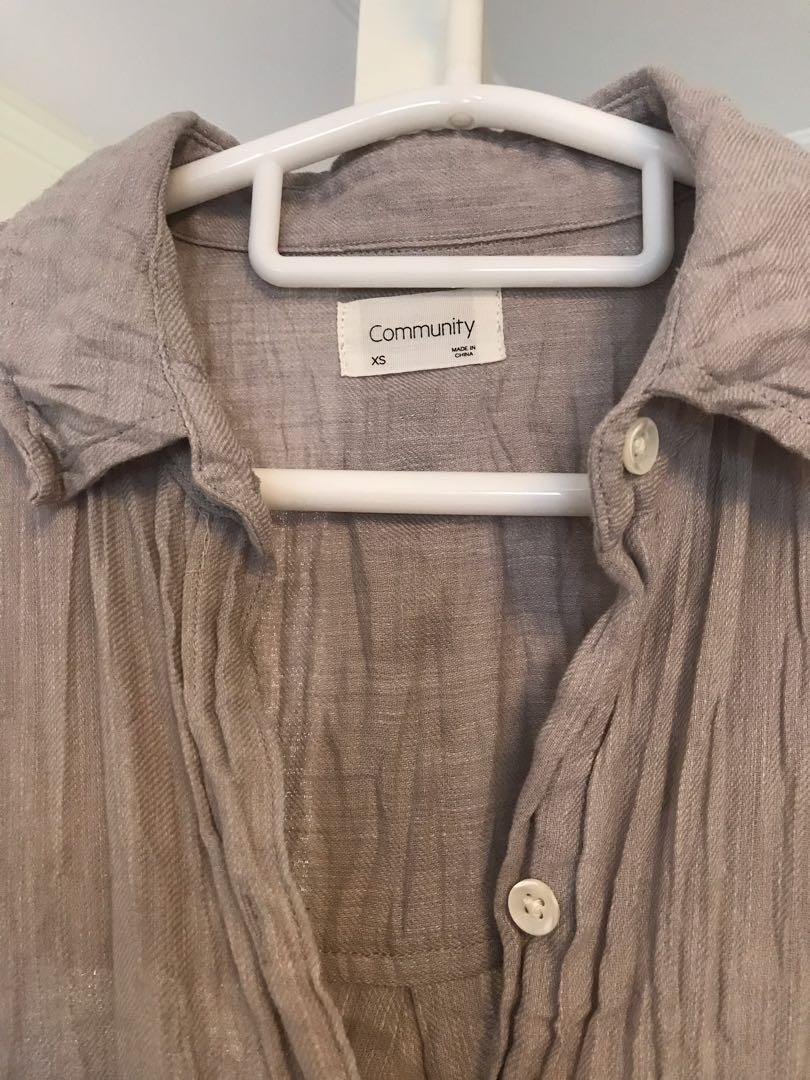 Community Aritzia button down shirt as seen on Meghan Markle