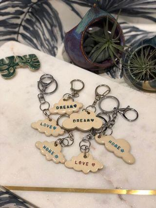 🚚 Handmade ceramic Cloud keyring/keychain in carious cloud shapes plus colours (listing is for one item only)