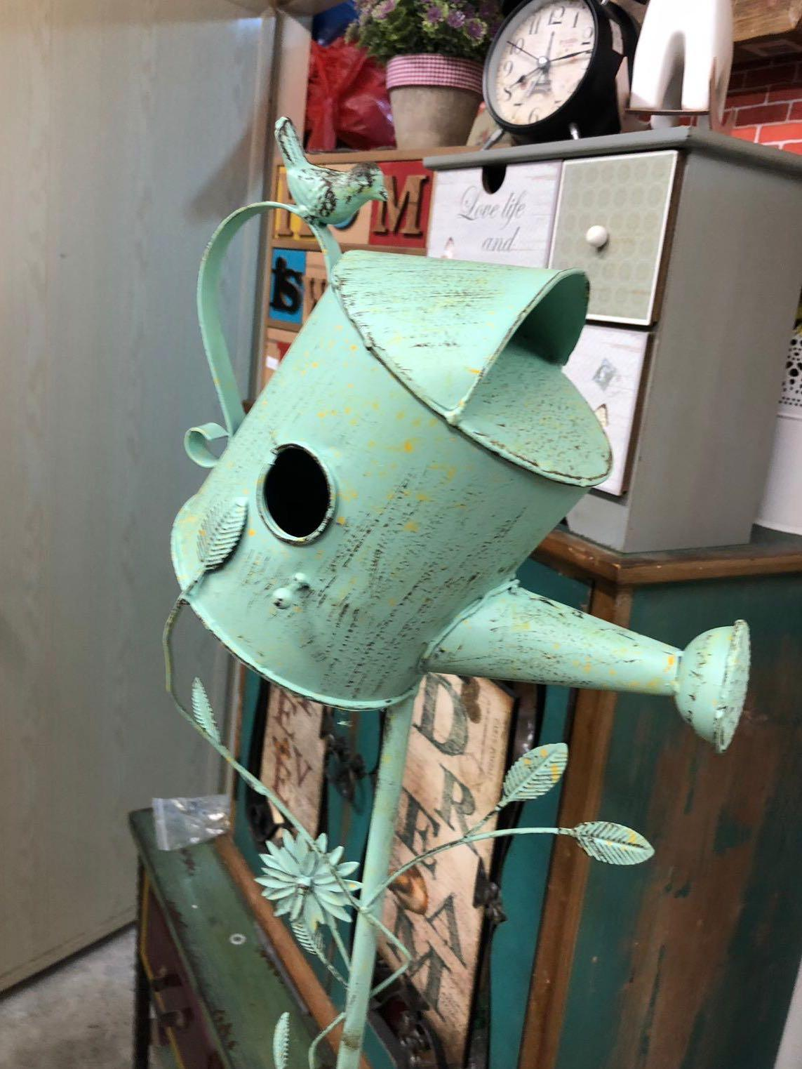 Turquoise garden watering can decor pick