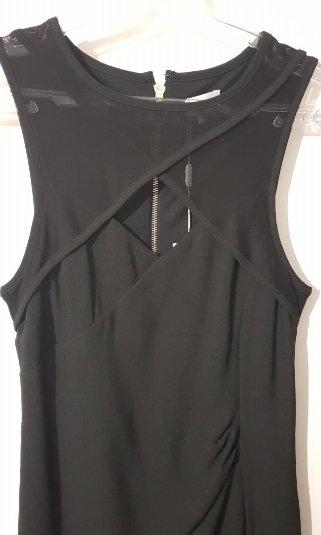New, still with tags. Tokito black dress. Size 8.