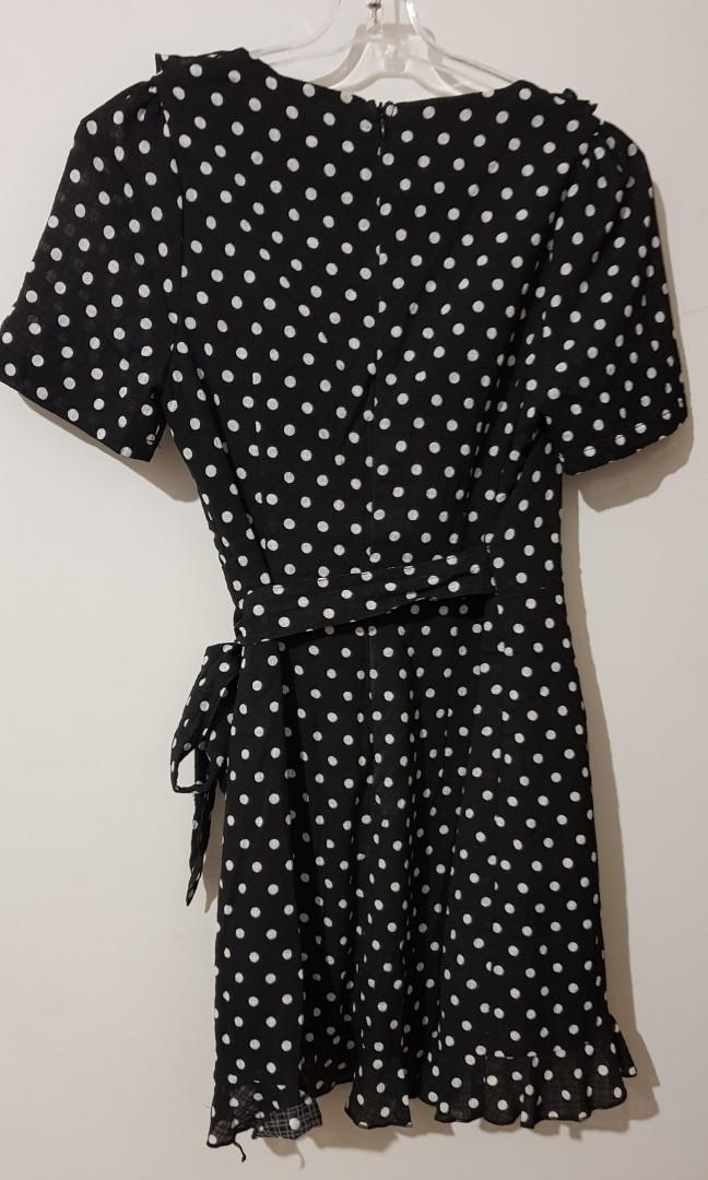 New, with tags. Black & white polka dot wrap dress. Size 10.