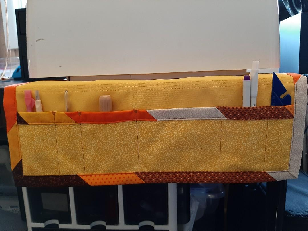 Non slip sewing machine mat with drop down storage pockets & patchwork binding