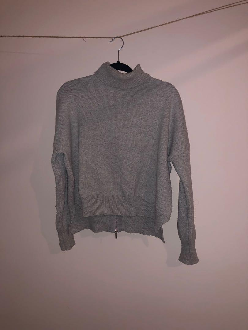 Grey knit oversized fit turtle neck with back zipper detail