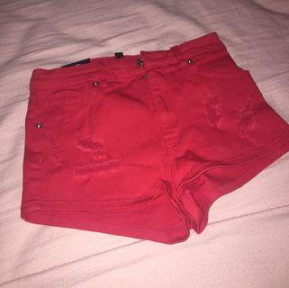 Red H&M shorts