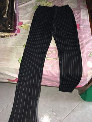Black elastic pants with thin white stripes