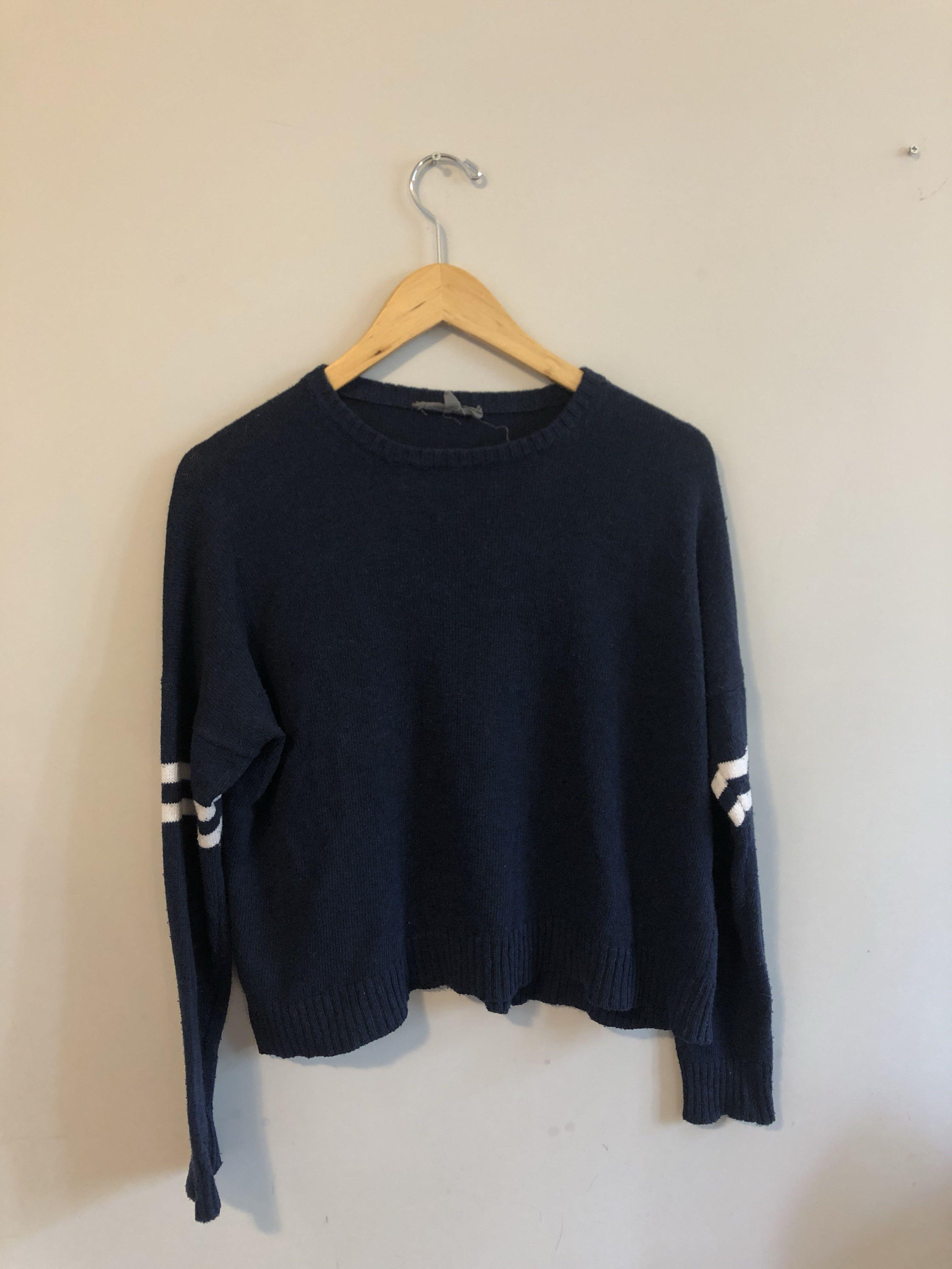 American Eagle navy blue sweater with white strips on sleeves