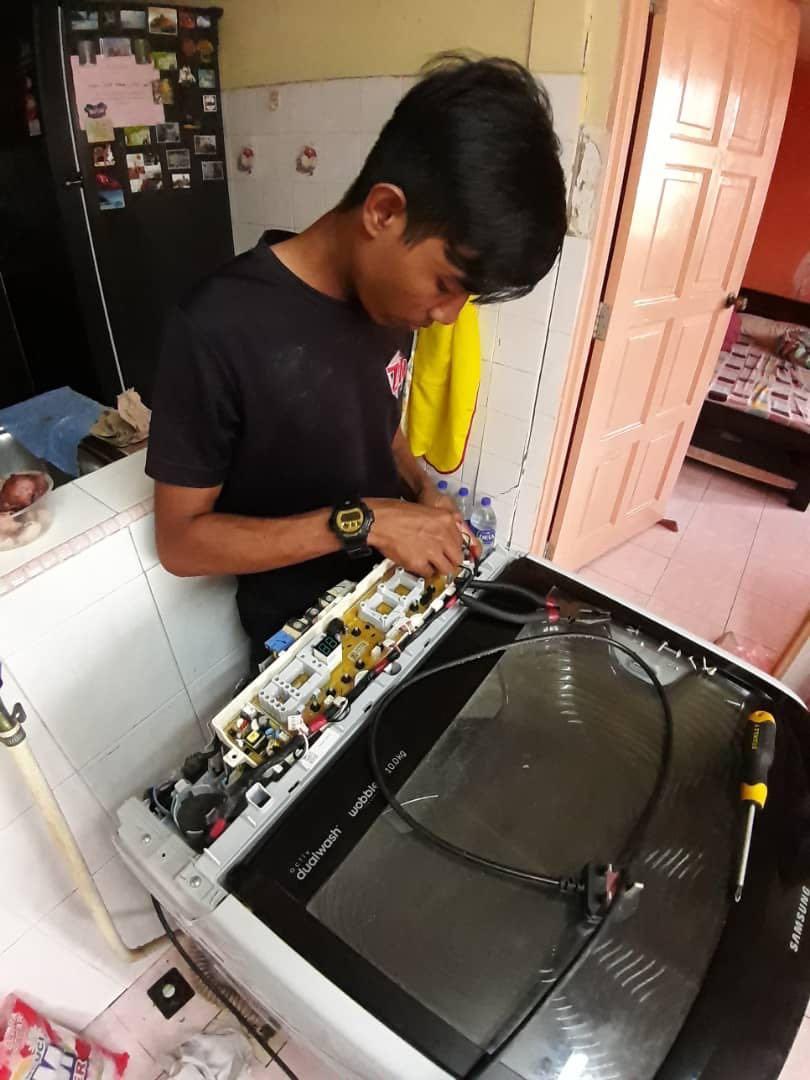Rapair mesin basuh peti sejuk