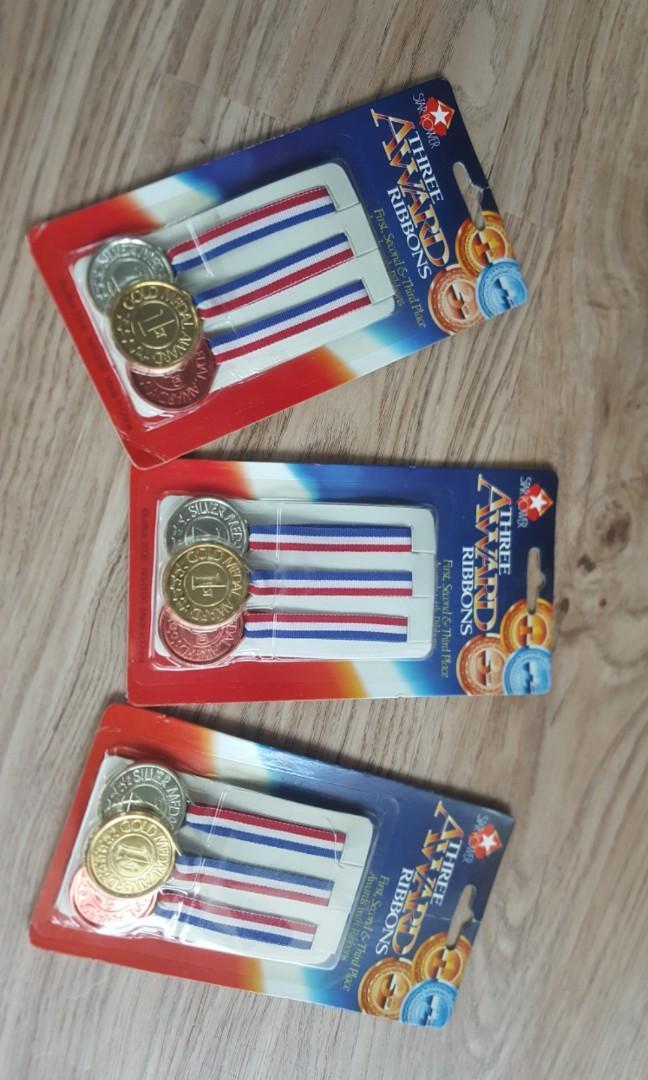 Three awards ribbons