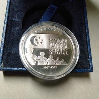 Singapore 25 years national service silver proof medallion.