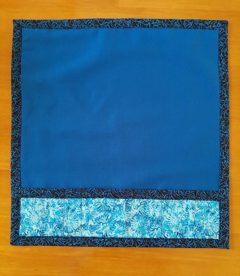Non slip sewing machine mat with drop down storage pockets