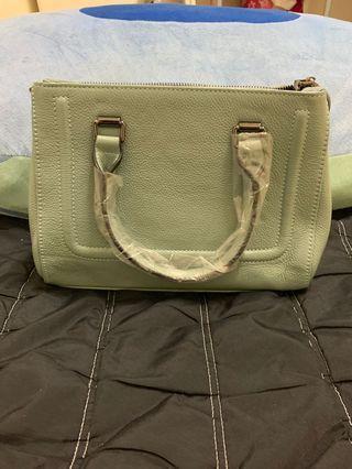 其實本身是莫藍迪的顏色全新ROBINLO真牛皮精品包包兩用包 原價6千多