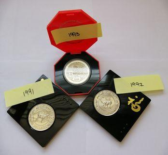 Seven years Singapore $10 coins