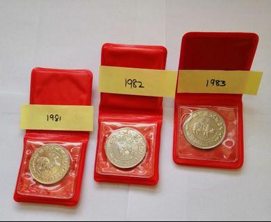 Ten years Singapore $10 coins