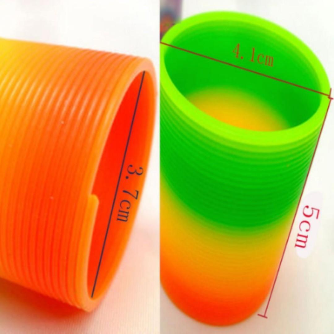 NEW Magic Durable Plastic Slinky Rainbow Intelligence Children Development Toys
