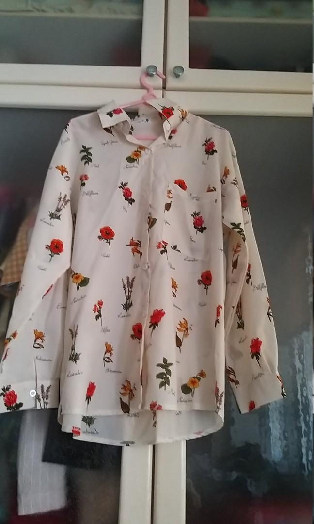 Brand new floral long sleeve blouse.  A bit baggy so may suite M