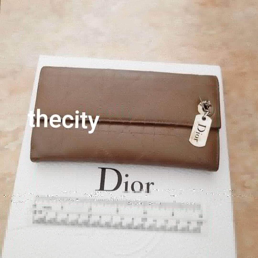 AUTHENTIC DIOR, LADY DIOR QUILTED LEATHER WALLET- COMES WITH DIOR SILVER CHARM - EXCELLENT CONDITION- CLEAN INTERIOR,  LEATHER EXTERIOR IN GOOD CONDITION - (DIOR LEATHER LONG WALLETS NOW RETAIL AROUND RM 5000+)