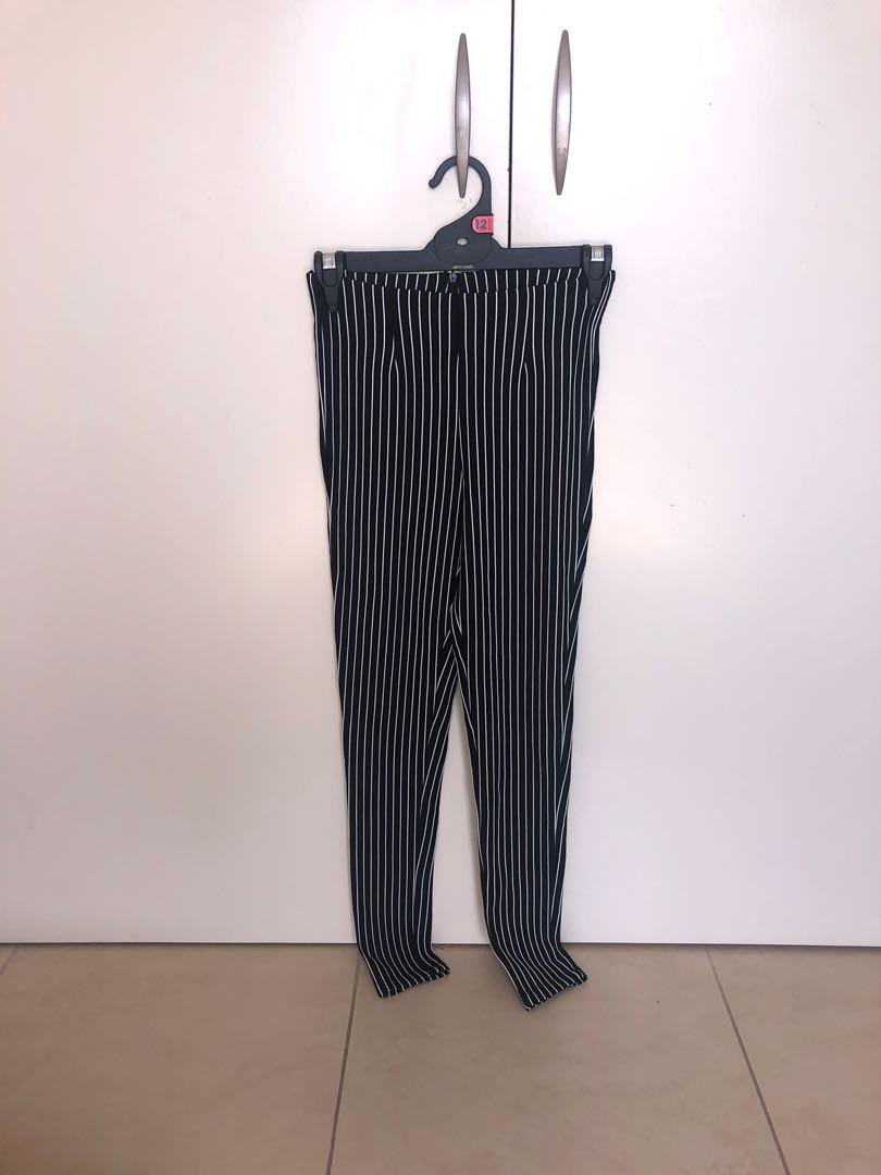 Princess Polly black and white stripped pants. Never worn.