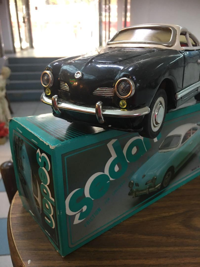 Vintage tin toy saloon car