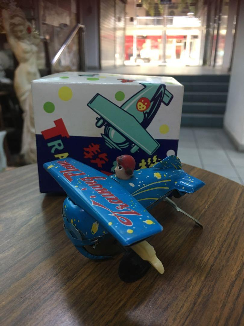 Vintage winding training plane with box
