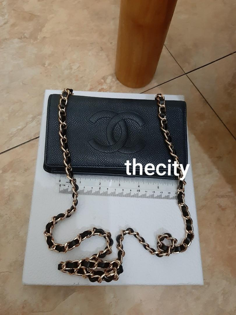 AUTHENTIC CHANEL BLACK CAVIAR LEATHER ORGANIZER / WALLET - CC LOGO DESIGN - IN VERY GOOD CONDITION , CLEAN POCKETS - EXTERIOR CAVIAR LEATHER IN BEAUTIFUL CONDITION - HOLOGRAM STICKER INTACT - COMES WITH EXTRA ADDED HOOKS AND LONG CHAIN STRAP