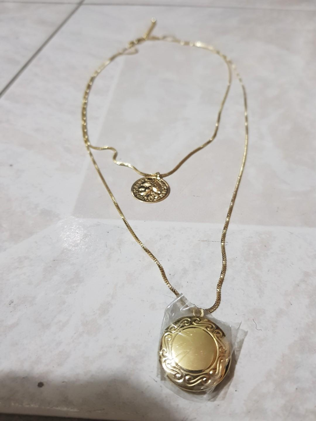 BRAND NEW - Costume gold necklace with locket and coin pendants