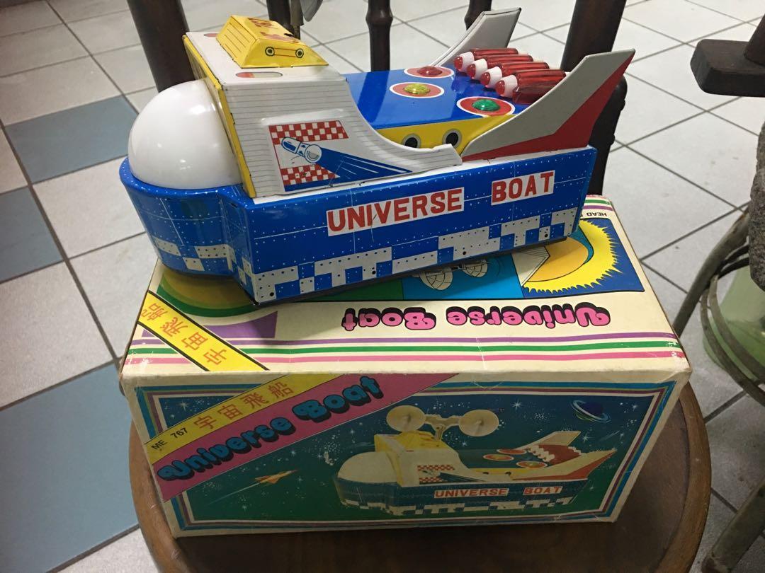 Vintage tin toy universe boat
