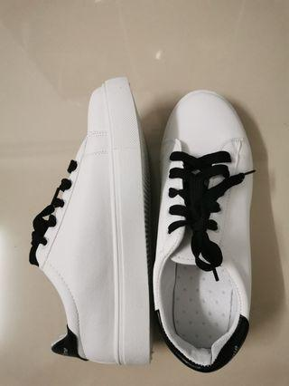 White shoes with black shoe lace