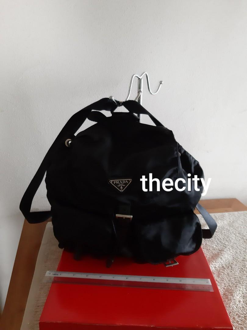 AUTHENTIC PRADA BLACK NYLON CANVAS BACKPACK - CLEAN INTERIOR - PREVIOUS JAPANESE OWNER SENT BAG FOR NEW PRADA INTERIOR RE-LINING AT PRADA BOUTIQUE ! (NEW RELINING AT PRADA COSTS AROUND RM 2000+) -  SO IN VERY GOOD CONDITION OVERALL