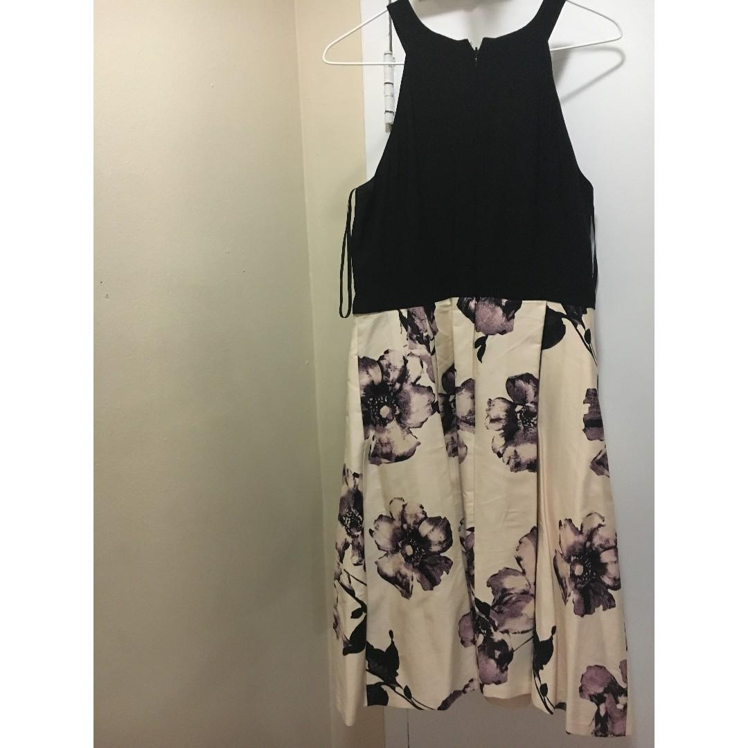 Black Le Chateau dress with flowers design. Size M (Original Price $159)