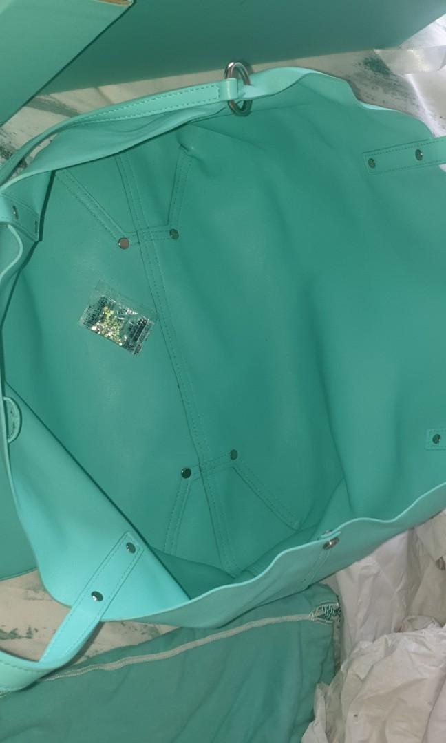 Genuine Tiffany and Co Leather Bag Tote - Tiffany Blue. Condition is Pre-Owned.