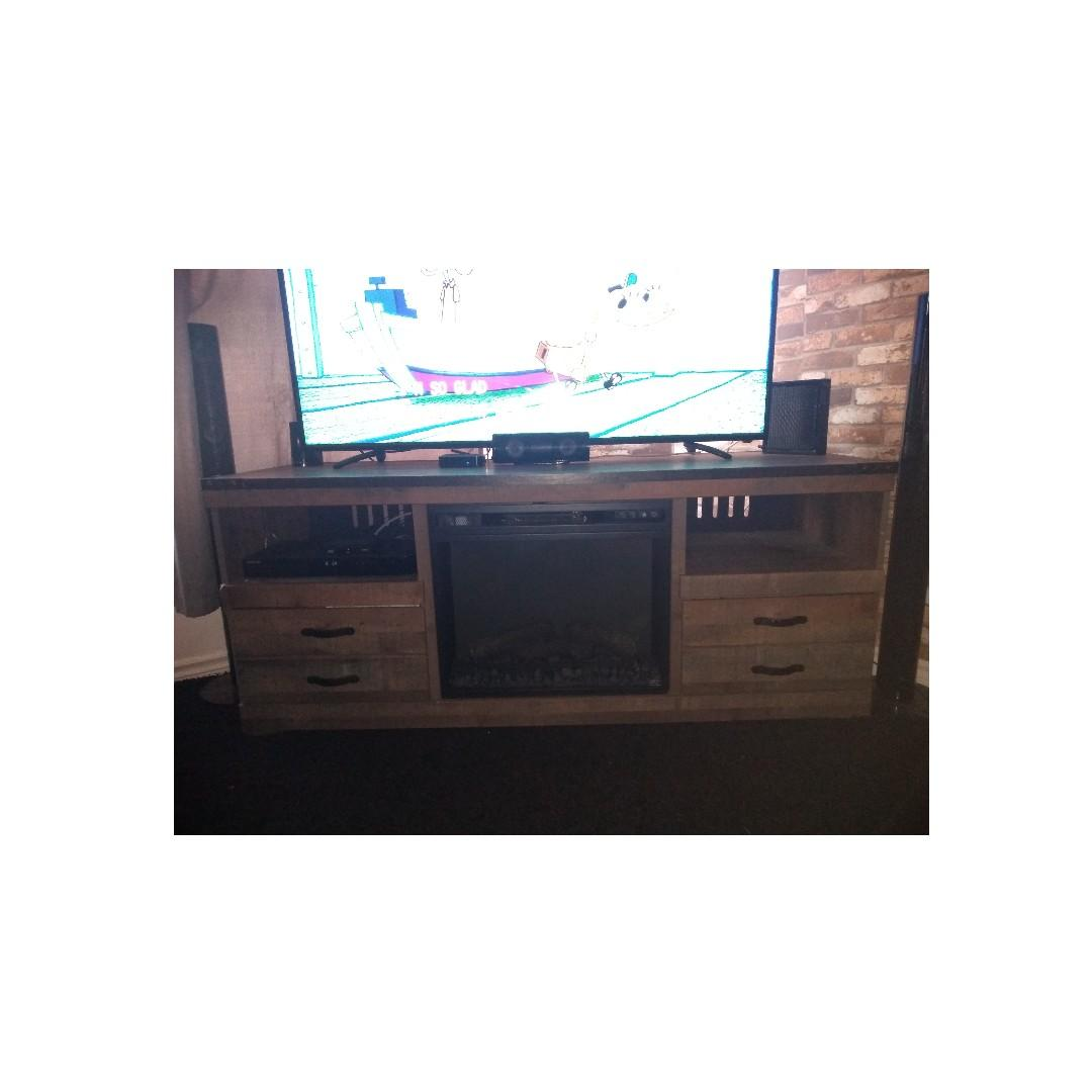 """63"""" fireplace tv stand. like new text 647 609 2104"""