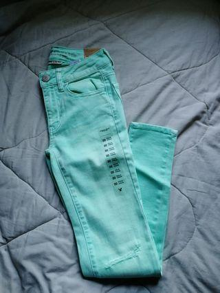 Mint green distressed jeggings |AE