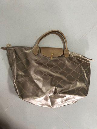 Longchamp non-authentic limited edition metallic gold short handle bag
