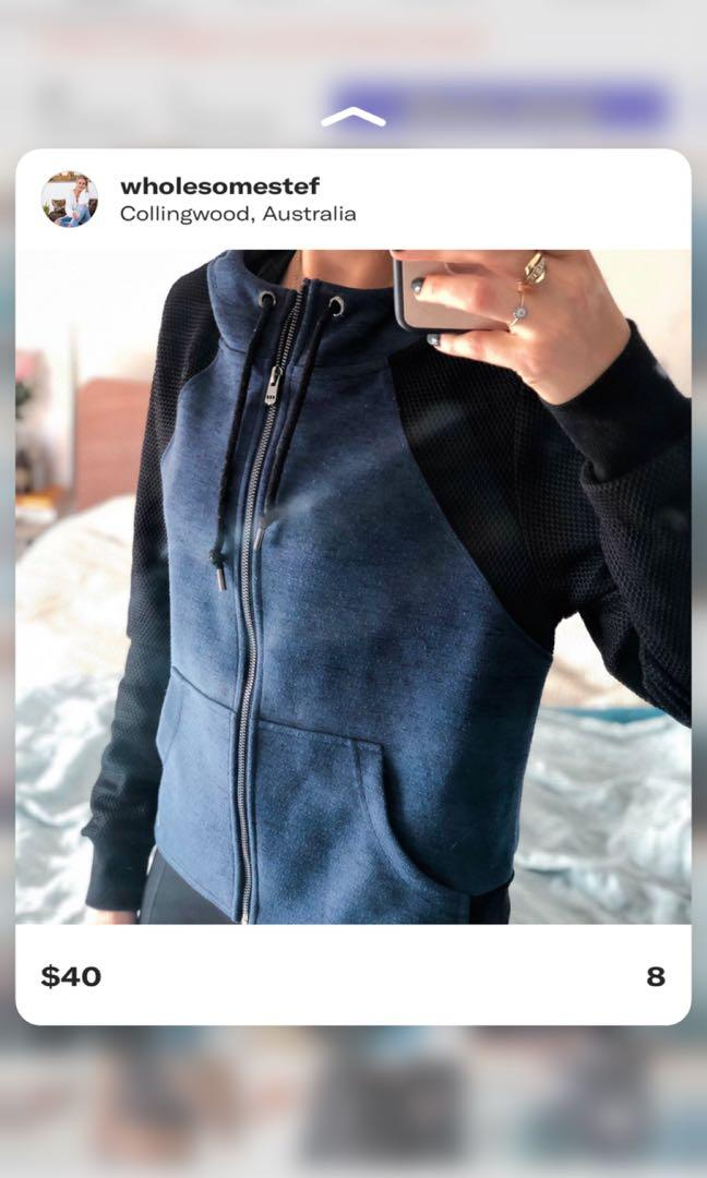 Black & dark blue Lorna Jane sweater with front zipper and hoodie. Only worn a handful of times.