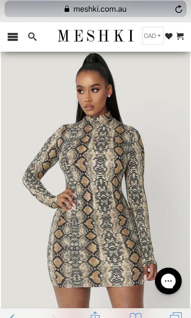 Meshki  print dress , Size small ,fits size 4-8 Retail price is $73