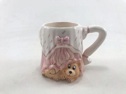 Bear under the pink table Mug
