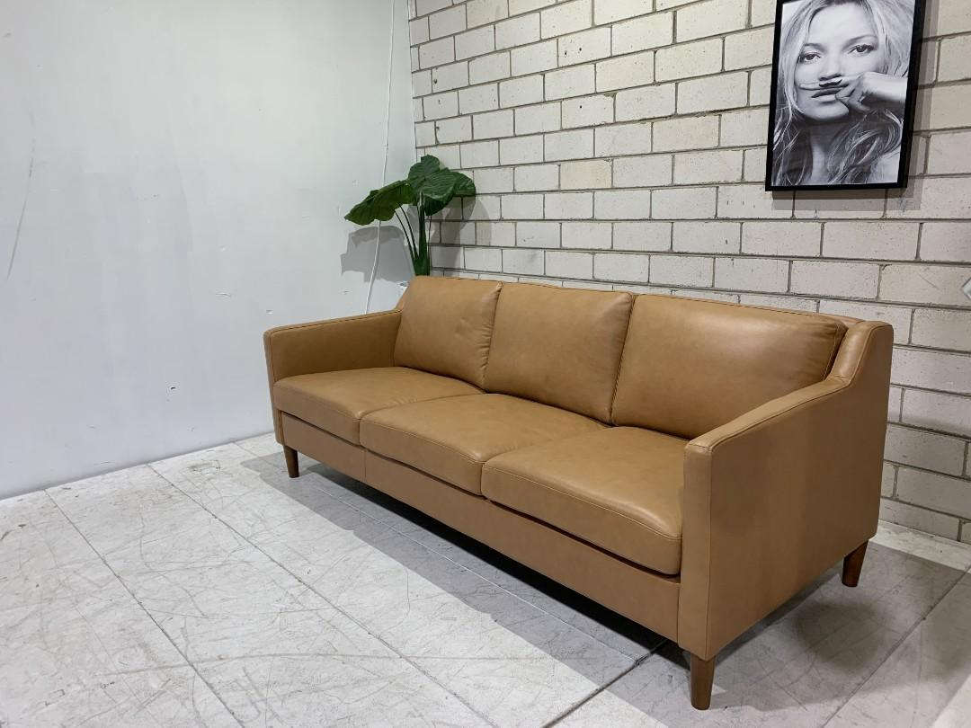 3 seater tan leather sofa lounge from a high end retailer