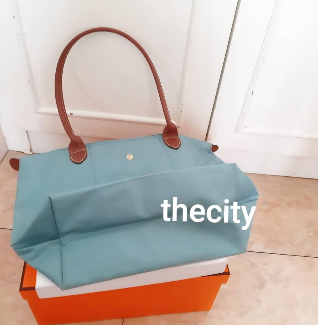 AUTHENTIC LONGCHAMP MEDIUM LE PLIAGE LONG HANDLES , CAN SHOULDER CARRY - CLEAN INTERIOR,  GOOD CONDITION,  ONLY USED FEW TIMES - COMES WITH CARE CARD