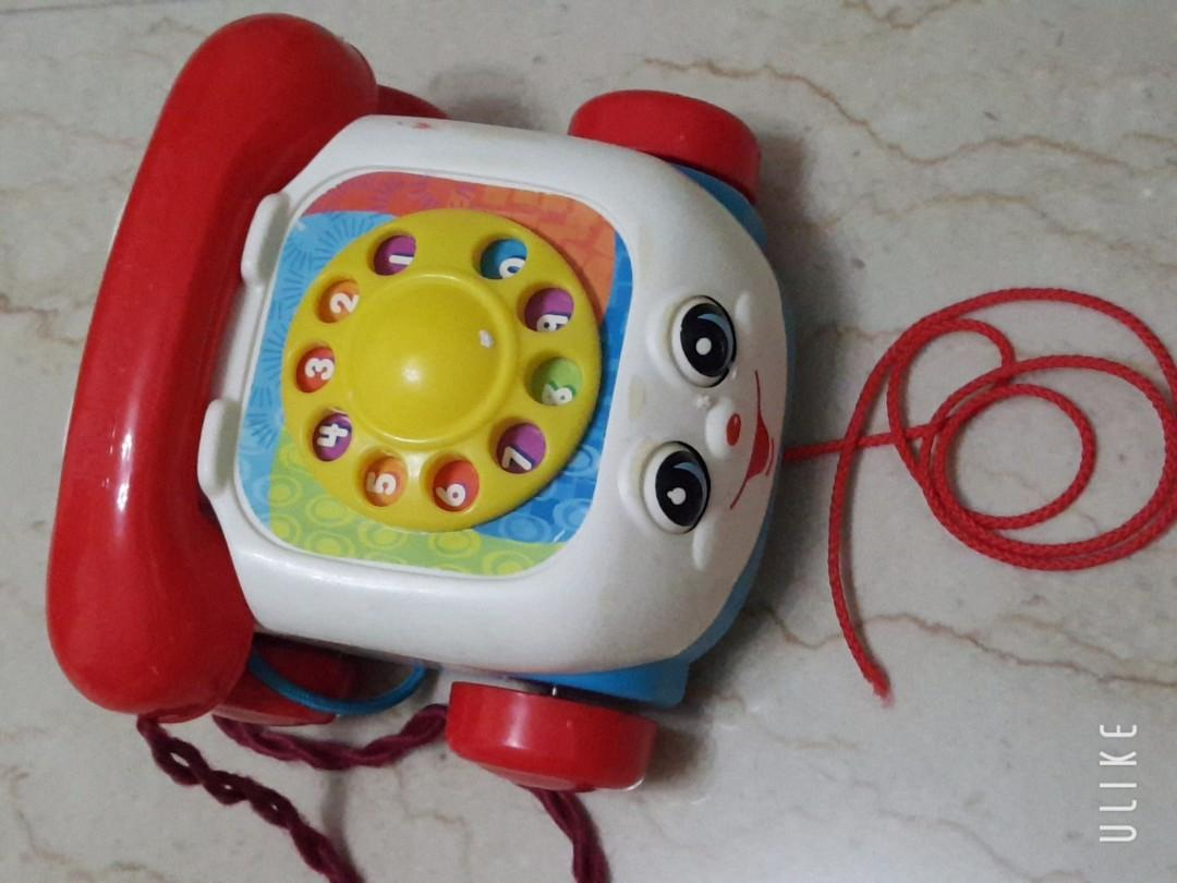 Toy phone with dialling sound and rolling eye