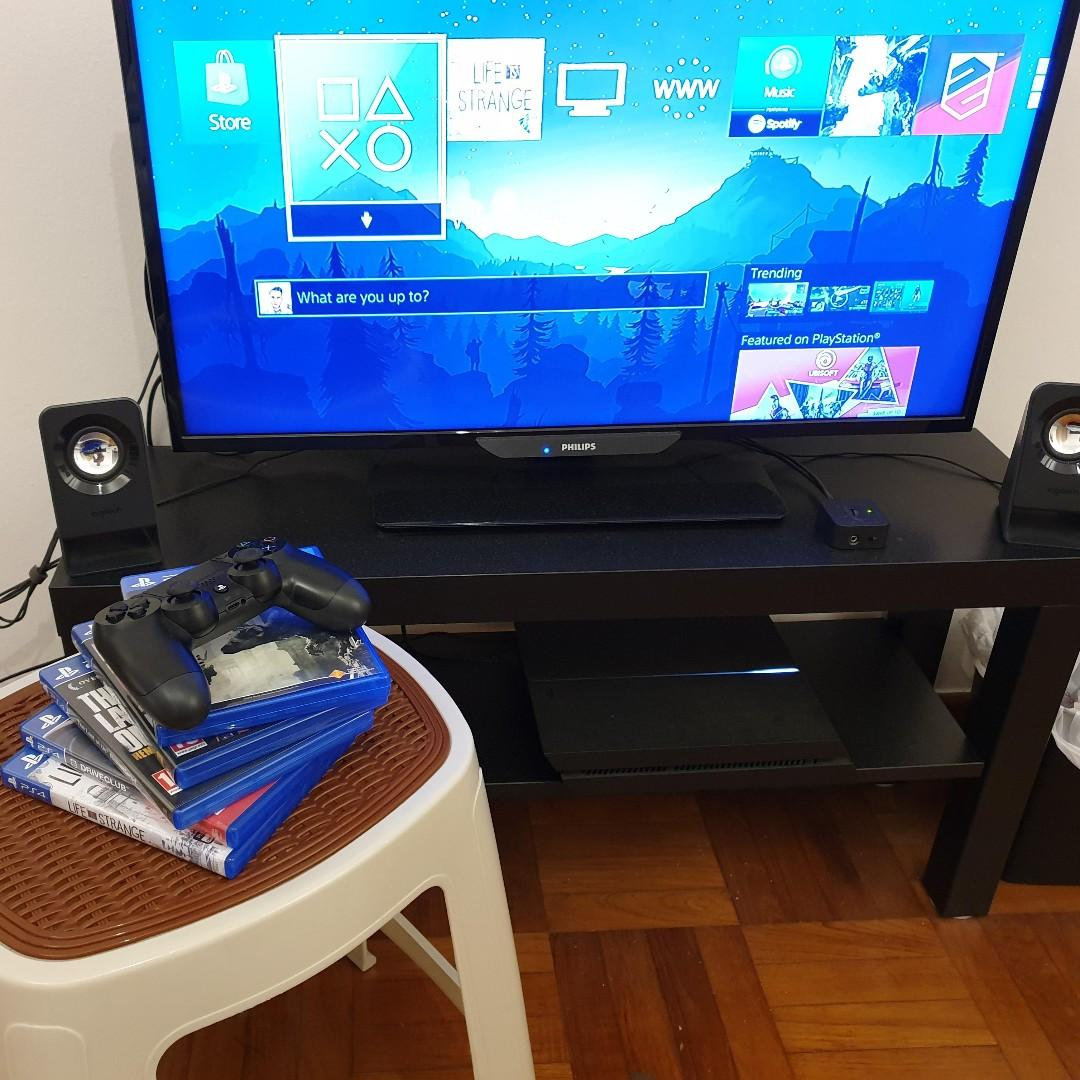 Sony PlayStation 4 1TB with two controllers and 5 games