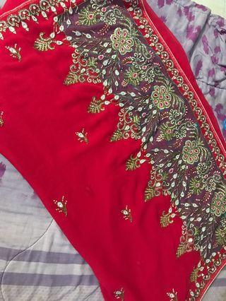 Dark pink saree with heavy embroidered ans stone work